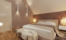 Спальня в мансарде загородного дома