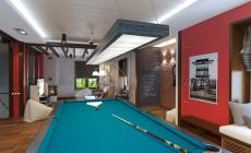 Зал отдыха для игр и занятий спортом в мансарде загородного дома