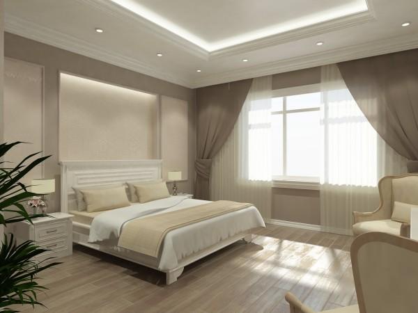 Интерьер спальни в классическом стиле в пастельных тонах.